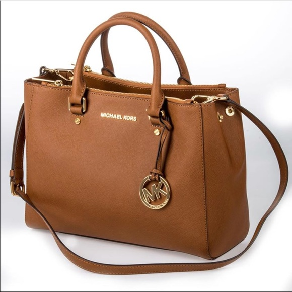 Mk brown purse. M 5b0cb0f33b16081b7c94826d e08bf8caf9557